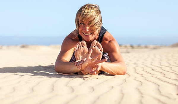 Rachel Blunt yoga pose with Gyan mudra at Corralejo Dunes